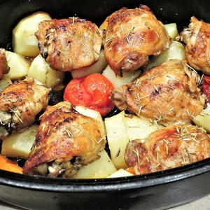 Medium roasted chicken thighs  potatoes  carrots  tomatoes