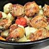 Thumb roasted chicken thighs  potatoes  carrots  tomatoes